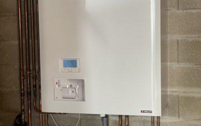 installation a dampmart d'une chaudière frisquet hydroconfort 20 kw avec ballon inox de 80 l a condensation